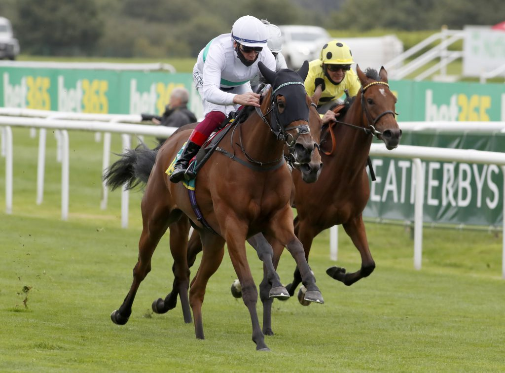Indigo Girl and Frankie Dettori winning The bet365 May Hill Stakes  Doncaster