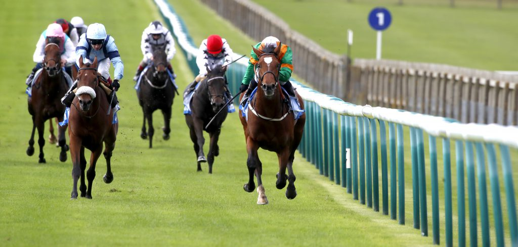 Lone Eagle and Silvestre De Sousa (right) winning The Godolphin Flying Start Zetland Stakes from Recovery Run Newmarket